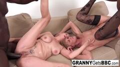 Naughty Masked brunette MILF sucking cock through glory hole Thumb