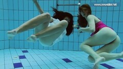 Hotly dressed teens in the pool underwater Thumb